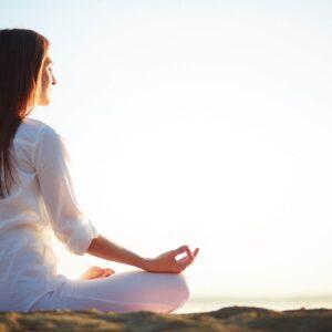 woman-sitting-yoga-pose-beach-2048x1365-1